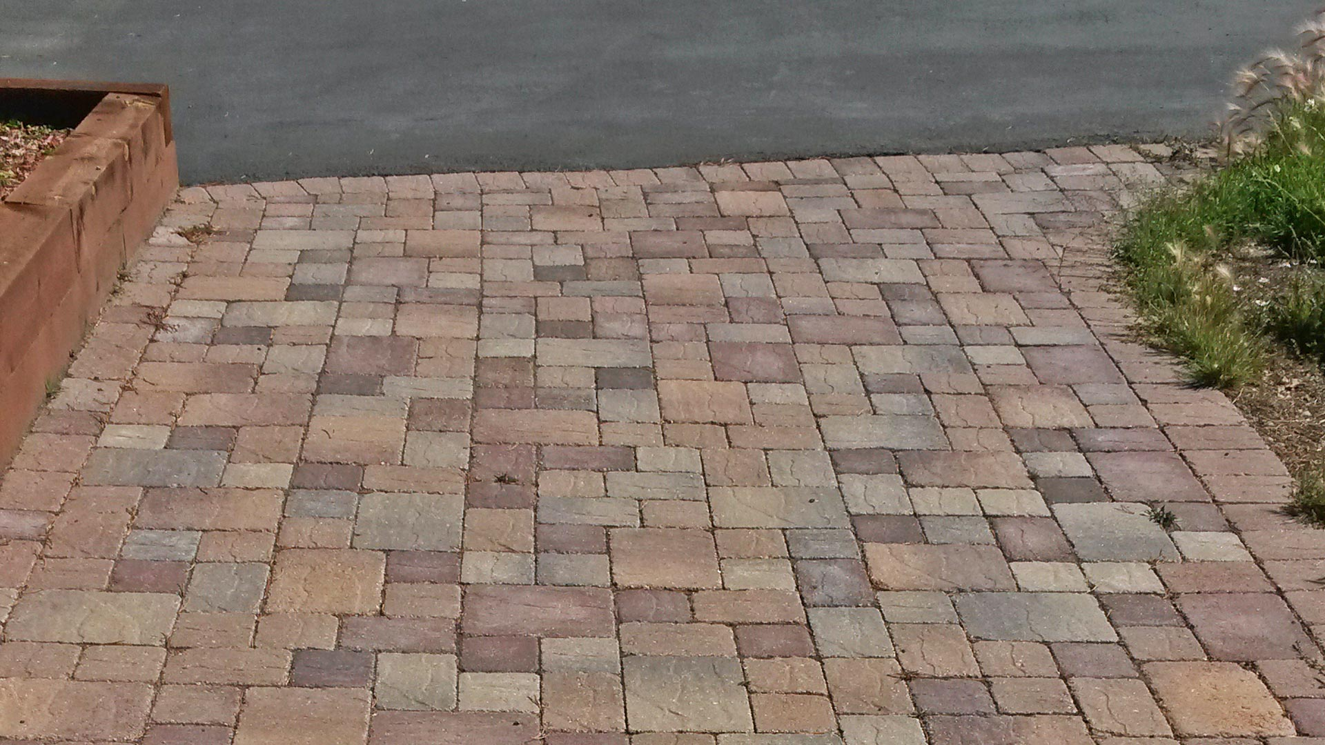 Brick paver driveway installed at a home in Winter Park.