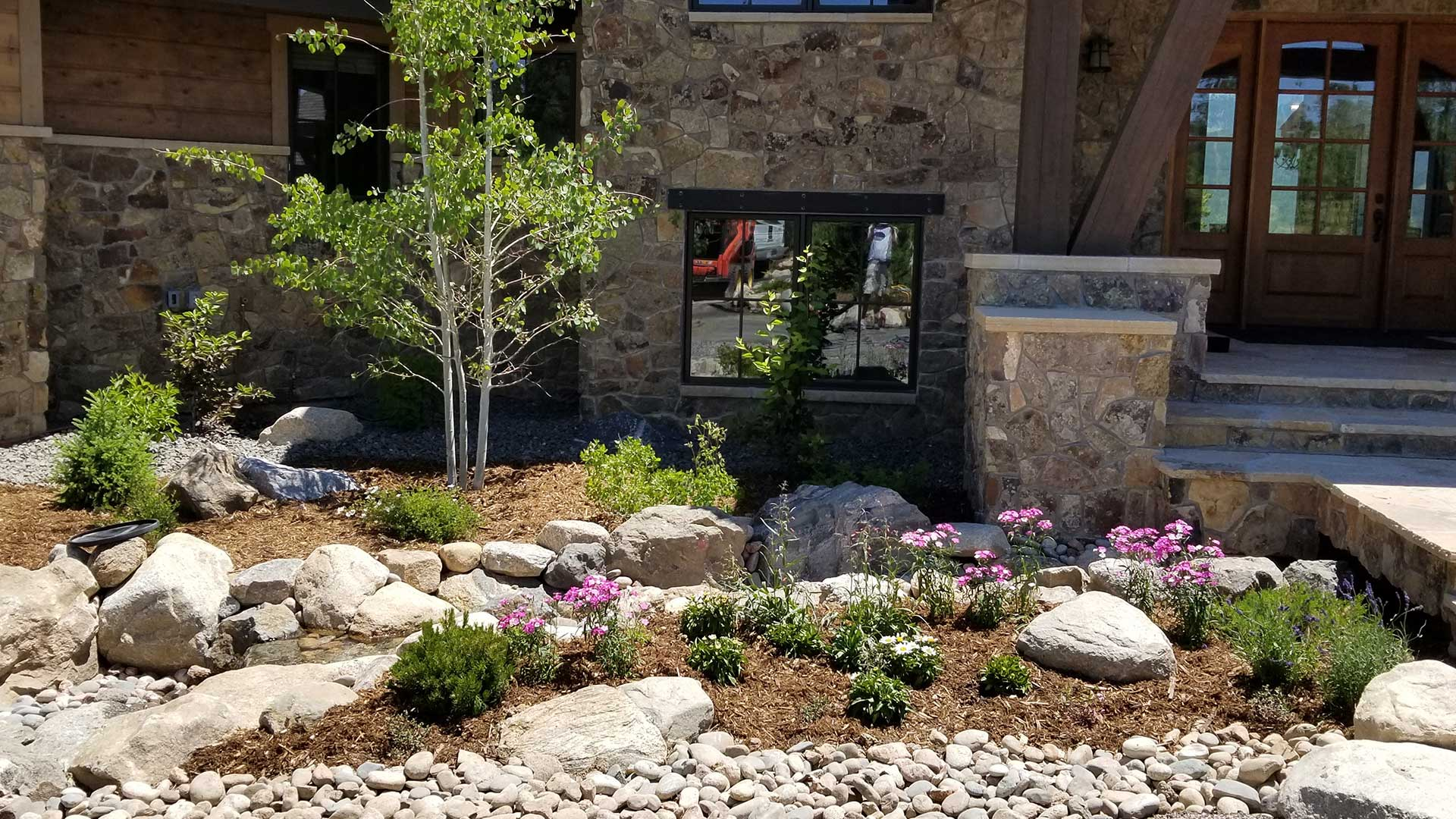 Landscaping in the front of a satisfied customer's home.