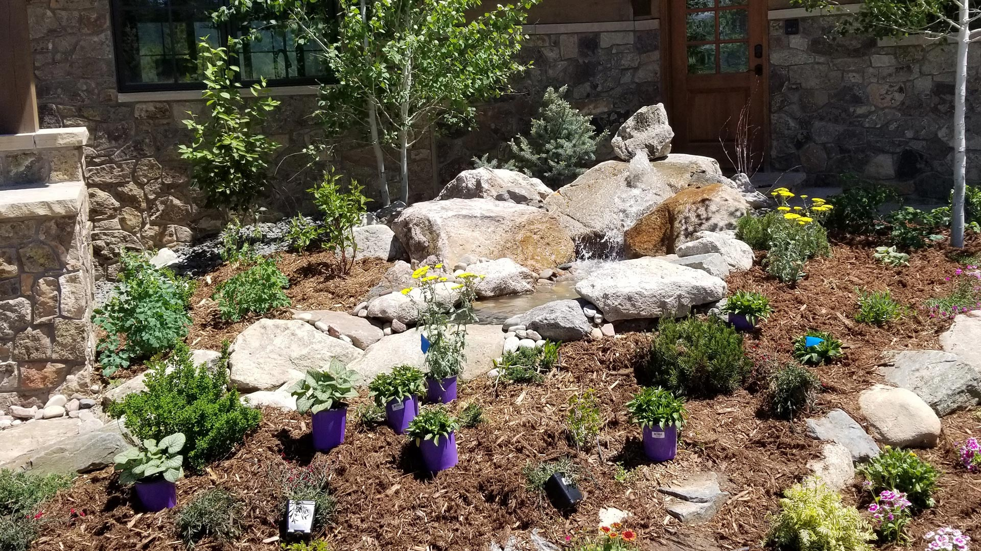 Preparing a landscaping bed for plantings in front of a residential home in Winter Park, CO.