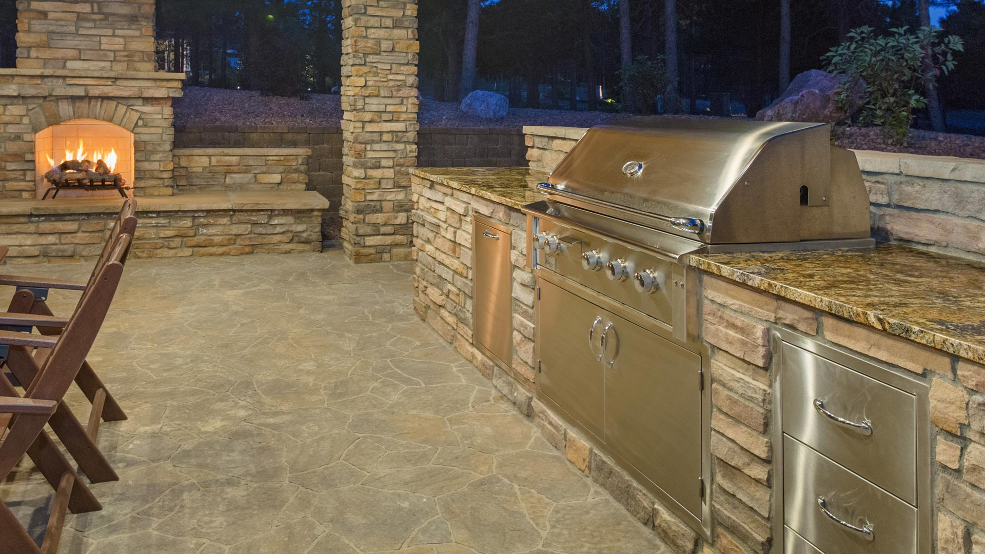 Outdoor kitchen with fireplace built at a home in Fraser, CO.