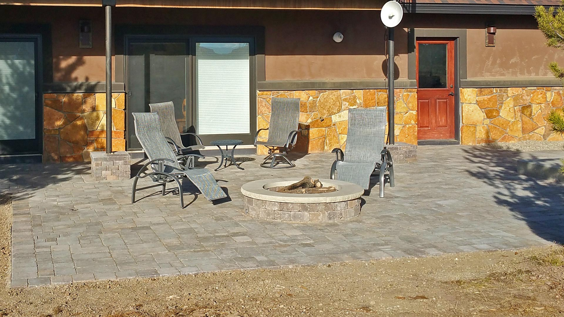 A new paver patio that was installed by our team of professionals in the back yard of a home in Fraser, CO.
