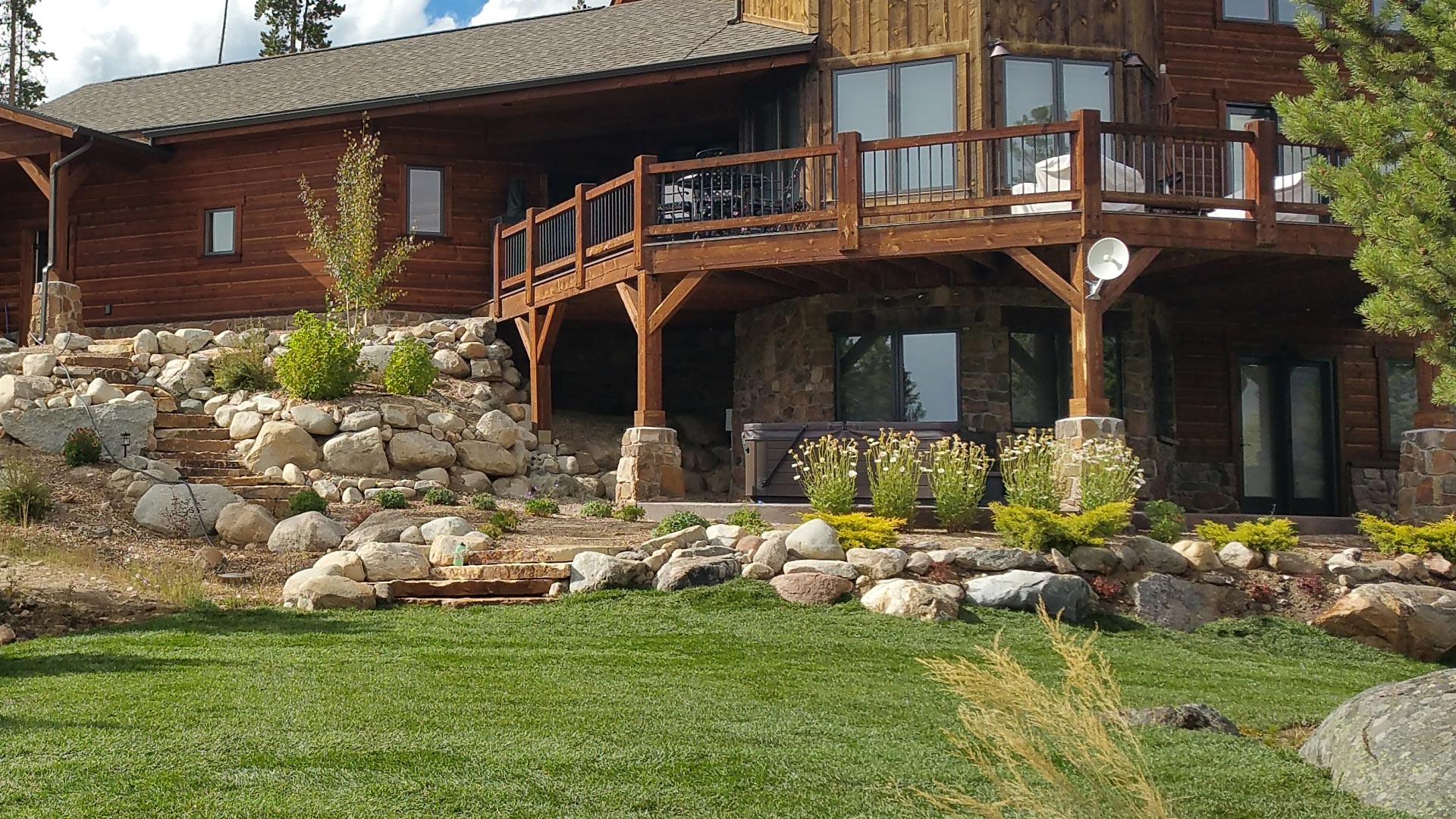 A completed project at a home in Winter Park, CO that includes hardscaping and landscaping.