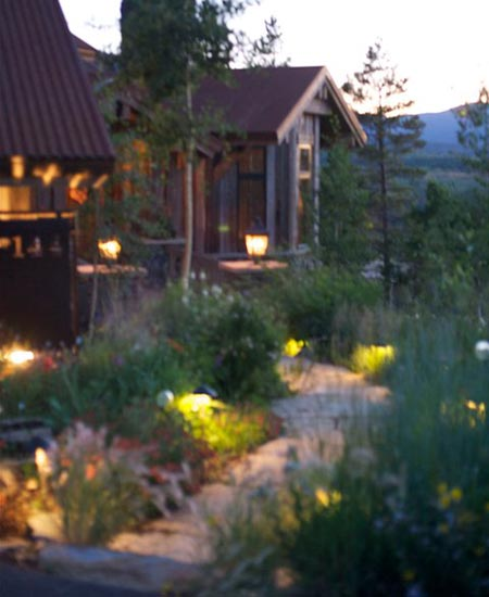 Outdoor landscape lighting in front of a home in %%targetarea2%,CO.