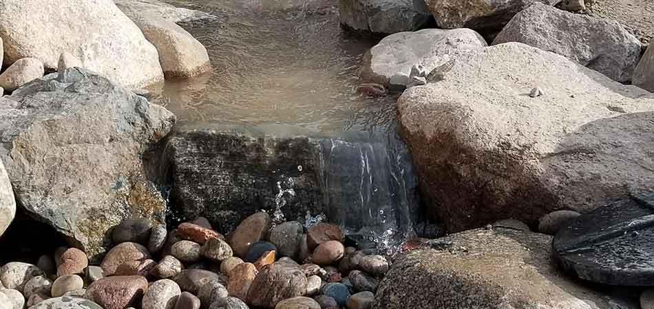 We used stones that came from a nearby riverbed for this stream that we built for a Tabernash customer.