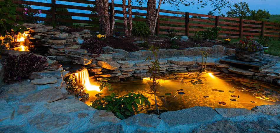 Outdoor lighting can spotlight ponds as well as landscaping in Winter Park, CO.