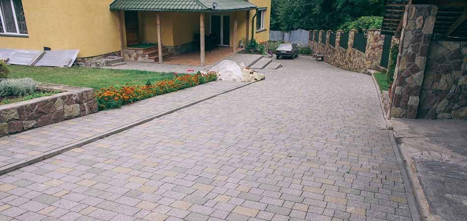 Our newest client in Tabernash was a project that necessitated building their decorative driveway on a slope.