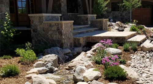 New hardscaping project that includes steps, pathway/walkway, bolder scape, and landscaping at a home in Winter Park, CO.