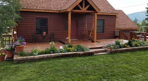 Landscaping in front of a cottage in Fraser, CO.